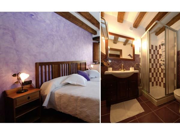 habitación lila y baño